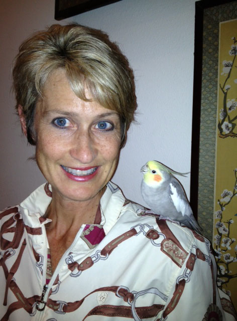 Kimberly Anchell and George, her cockatiel